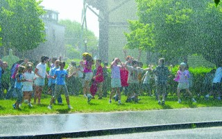 Chatham kids get cooled down by a fire hose in the summer of 2004. FILE PHOTO  (photo: Timothy J Wood)