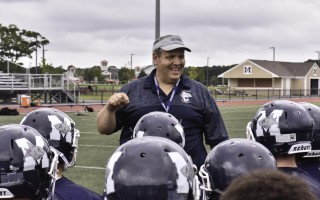 Monomoy football coach Larry Souza instructs players at the start of a conditioning practice last week. Souza was named head coach at the end of the last school year.  KAT SZMIT PHOTO  (photo: Kat Szmit)