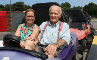 "Harwich Chamber of Commerce Executive Director Cyndi Williams and the grand marshal of this year's Harwich Hometown Parade, Emulous E. ""Buddy"" Hall, prepare to take off in one of Bud's Go-Karts. WILLIAM F. GALVIN PHOTO  (photo: )"
