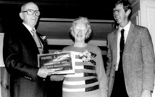 Former Conservation Commission Chairman Daniel J. Larkin is honored for his decade of service. He is joined by his wife, Mary and Selectman Allin Thompson. 1989. FILE PHOTO  (photo: )