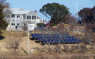"Many homeowners have been doing their part to make Orleans ""greener"" by using solar power. This residential array overlooks Woods Cove. ED MARONEY PHOTO  (photo: Ed Maroney)"