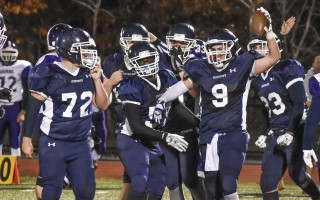 Monomoy's Eli Nickerson (9) holds up a recovered fumble that was a key moment in the Sharks' 28-26 victory against Bourne last Thursday, making the 2016 team the winningest in MRHS history. Kat Szmit Photo  (photo: Kat Szmit)