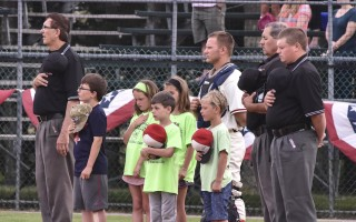 Kids join their favorite officials and players at home plate at Whitehouse Field for the National Anthem before a recent Harwich Mariners game. Kat Szmit Photo  (photo: Kat Szmit)