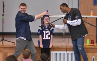 Ashley Anderson hopes that magician John Duke Logan and New England Patriots wide receiver Malcolm Mitchell don't spill orange juice on her head during a magic trick. 