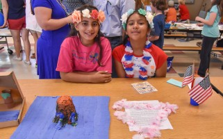 Amberlis Hidalgo and Ashley Guzman show off their Hawaiian volcano, and their traditional Hawaiian attire.  (photo: Kat Szmit)