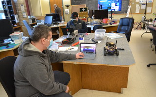 Cape Cod Makers member Jesse Craig points to a laptop to show how his robotic car's camera can be displayed on a computer at the makerspace inside the Harwich Cultural Center. BRAD JOYAL PHOTO  (photo: )