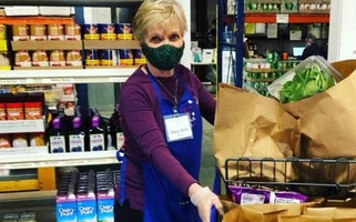 Only volunteers are allowed inside the pantry, and they are temperature-screened before each shift and wear personal protective gear.  COURTESY PHOTO  (photo: )