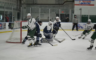 Mashpee-Monomoy goaltender Dom Tsoukalas (middle) braces for a shot during the second period of Monday's game against Dennis-Yarmouth at Tony Kent Arena in South Dennis. BRAD JOYAL PHOTO  (photo: )