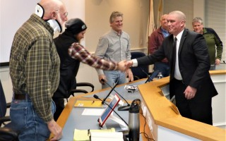 Geof Deering shook hands with Selectman David Currier and the rest of the board Feb. 20 after being appointed as the town's incoming fire chief.  ED MARONEY PHOTO  (photo: Ed Maroney)