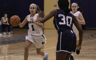 Monomoy's Lucy Mawn (1) keeps an eye on Nantucket's Malika Phillip (30) as she and teammate Maddie Crossen move the ball down the court during game play on Feb. 10. Kat Szmit Photo  (photo: )