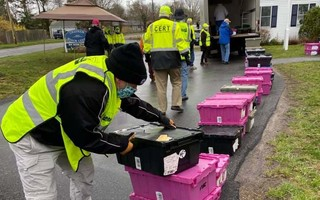 Community Response Team members pack up food to deliver to seniors at the Chatham Senior Center in April. FILE PHOTO  (photo: )