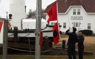 Crews hoist the hurricane flags at Chatham Light. FILE PHOTO  (photo: )