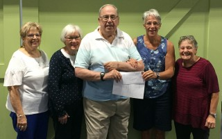 Among the many contributors to Helping Neighbors are the members of the Mid-Cape Chorus, who contributed $1,200 from the proceeds of their May 26 concert at Pilgrim Congregational Church. Pictured with Pantry Executive Director Christine Menard (second from right) are members (from left) Sue Shields, Arlene Bowler, Patrick Bowler and Conductor Melodi Southworth (right). COURTESY PHOTO  (photo: )
