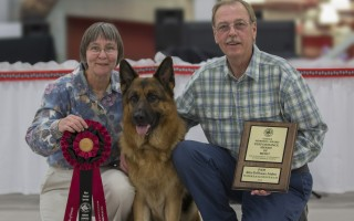 Jack Burns and Lynda Brogden-Burns pose with Aiden, winner of the Performance Award of Merit from the German Shepherd Dog Club of America last month. ANDREA WRIGHT PHOTO  (photo: Andrea Wright)