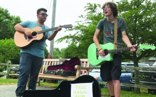 Buskers in downtown Chatham. Selectmen have asked staff to develop a bylaw to regulate activities such as busking, sale of balloons at band concerts and the outdoor display of goods. FILE PHOTO  (photo: Tim Wood)