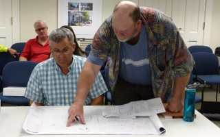 Tom Parece, seated, AECOM's senior program director, conferred with the town's water superintendent, Todd Bunzick, during an informal site plan review session last week.  ED MARONEY PHOTO  (photo: Ed Maroney)
