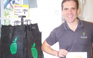 "Friends' Marketplace owner Brian Junkins offers paper rather than plastic bags at his checkout counters, but by making contributions to a variety of non-profit groups, he ""incentivizes"" customers to bring their own multi-use bags. 