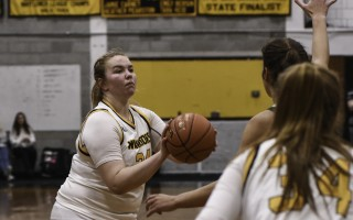 Nauset's Skyeler Sandison (24) keeps her eye on the hoop as she nears the 1,000-point mark of her high school career near the start of the Warriors' Jan. 10 game against D-Y. Sandison not only reached the milestone in the game, but surpassed it. Kat Szmit Photo  (photo: )