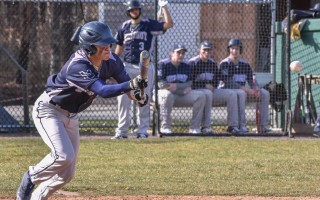 Monomoy's Nathan Amaker executes a stellar bunt and gets set to race to first during the Sharks' Monday game against Sandwich. Amaker brought in all three of Monomoy's runs in the game. Kat Szmit Photo 