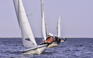 Monomoy sailors Julia Rioux and Eddie Goggin in Boat 1, and Jan Lapinski and Lindsey Mellett in Boat 2, sail to victory in an informal race against D-Y on May 2 on Pleasant Bay. Kat Szmit Photo 