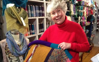 Knitter Susan O'Leary is busy creating blankets out of panels created by local knitters for this year's knit-a-thon, which benefits the Homeless Assistance Corporation and is sponsored by A Great Yarn in Chatham. DEBRA LAWLESS PHOTO 