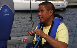 Matt Chao rigging mainsail at Japan Blind World Championships 