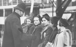 A port official greets children disembarking in Harwich, England during the Kindertransport of Germany refugee movement in 1938. COURTESY PHOTO PROVIDED BY THE WIENER LIBRARY  (photo: )