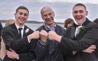 Monomoy varsity baseball coach Steve Wilson shares a moment with Griffen Handler (left) and Eli Nickerson (right) at the 2017 prom. Wilson recently announced his retirement from coaching due to health concerns. Kat Szmit Photo  (photo: )
