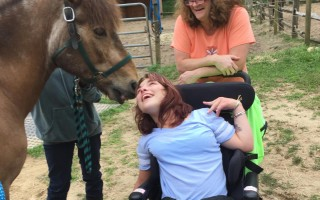 Emerald Hollow Therapeutic Riding Center student      Kacey and her Mom Kathy share a joyful moment with Geyser. KATE HANSEN PHOTO     (photo: KATE HANSEN)