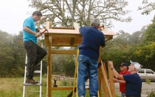 Members of the Chatham-Harwich Newcomers woodworking group construct a kiosk on the former Marini property, a 17-acre conservation area at the headwaters of Muddy Creek. The kiosk was built by the volunteers for the Harwich Conservation Trust and will provide maps and information for walking trails. KATHLEEN MAGNUSSON PHOTO  (photo: )
