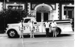 Harwich Selectmen Haden Greenhalgh, Barry Hemeon, firefighter Charles Urton, and Selectman Donn Griffin with the restored Buffalo fire engine in July 1977.   FILE PHOTO  (photo: )