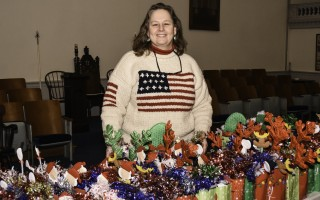 Polly Goddard stands behind rows of bags filled with holiday treats that were delivered to patients at the Veteran's Hospital in West Roxbury. The goodies are part of an annual program of Goddard's, in cooperation with St. Martin's Lodge, that she calls Treats for Troops. Kat Szmit Photo  (photo: )