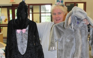"Community Center Director Carolyn Carey displays some of the Halloween costumes already donated to the ""Boo-tique"" for re-use by local kids. WILLIAM F. GALVIN PHOTO  (photo: William F. Galvin)"
