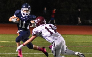 Gavin Viera (11) fends off a West Bridgewater foe during game play on Friday. Kat Szmit Photo  (photo: Kat Szmit)