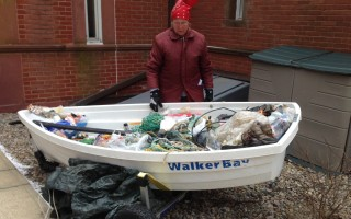 Rebecca Arnold displays a dinghy full of the trash she collected on Chatham beaches. She brought the dinghy to the Eldredge Public Library Saturday, where Pleasant Bay Community Boating sponsored a panel discussion on plastic pollution. DEBRA LAWLESS PHOTO  (photo: )