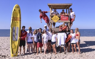 Mark Sullivan (center), a veteran lifeguard of Harding's Beach in Chatham who manned the chair in 1966 and '67, returns to the sand for a 50th anniversary photo with today's guards, including Samantha Bernard, Kelly Barry, Emma Briody, Olivia Brown, Charlie Callaghan, India Callaghan, Lizzie Douglass, Peter Hano, Libby Hart, Alise Montgomery, Jaime Montgomery, Joe Murphy, Sadie O'Malley, Erin Payne, Joshua Rosen, Connor Round, Julia Taylor, Robert Toffolon, Katie Van Amson, Caroline Verrilli, Andrew Verrilli, Jake Whitfield, and Jack Winslow. Kat Szmit Photo  (photo: Kat Szmit)