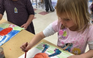 "Chatham Elementary School kindergarteners Annaleigh Massey, left, and Addy Goley paint pictures of monsters inspired by ""Where the Wild Things Are"" for the Eldredge Public Library's Books in Bloom event. 