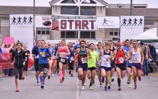 Runners set off from the starting line of the 2015 Harwich Cranberry Festival Half-Marathon. This year's event will take place Oct. 2 and will feature the half-marathon and 10K races, cash prizes, and a post race wine and beer garden. Chronicle File Photo  (photo: Kat Szmit)