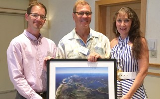 Michael Lach, left, executive director of the Harwich Conservation Trust, with Neil and Anna Rasmussen, chosen by the organization as its 2017 Conservationists of the Year. COURTESY PHOTO  (photo: Courtesy Harwich Conservation Trust)