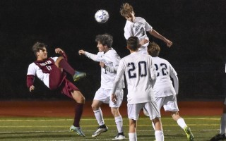 Monomoy's Sean Spies (7) and Cameron Archibald (17) work to prevent Millis's Thiago Piazzarollo (16) from putting the ball in the net during MIAA tournament play on Nov. 4. Kat Szmit Photo  (photo: Kat Szmit)