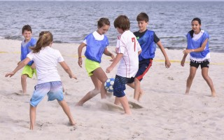 The Harwich Police Soccer Club's beach soccer program is back in action, kicking off last Thursday when kids delighted in getting their toes in the sand, and the ball, ideally, in the goal. Kat Szmit Photo  (photo: Kat Szmit)