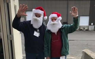 A pair of jolly holiday volunteers help out at the Family Pantry.   (photo: )