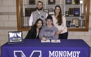 Monomoy lacrosse player Elijah Beasley celebrates his official signing with UMass Boston with mom Nicole Theoharidis, sister Angelina, and uncle Spero Theoharidis on Feb. 13. Kat Szmit Photo 