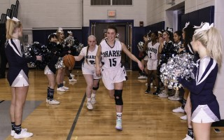 Monomoy senior Christiana Fontaine (15) heads onto the court before being celebrated on Senior Night by the team. Kat Szmit Photo  (photo: )