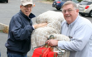 Resident John Young (left) hands a donation of linens to Family Pantry volunteer Tim Malarky. Some donated items benefit clients directly, and others stock the shelves at the Family Pantry's upscale thrift store, Second Glance. ALAN POLLOCK PHOTO  (photo: Alan Pollock)