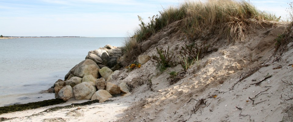 The Town Has Tried Unsuccessfully To Stem Erosion At Tip Of Red River Beach Using