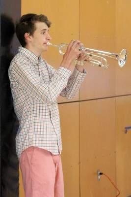 Liam Lawless plays Taps to honor fallen veterans.
