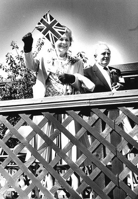 Harwich Deputy Mayor Gladys Cooper and her husband, Jack, serve as judges in the Harwich Cranberry Festival Parade in 1985. FILE PHOTO