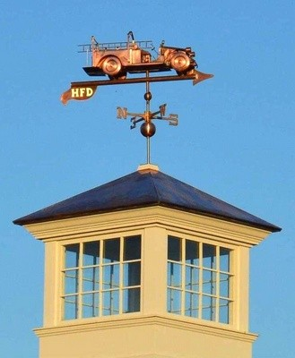The department's 1928 Maxim fire engine is featured on the weathervane. SCOTT TYLDESLEY PHOTO