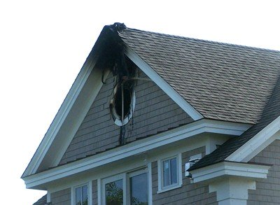 A probable lightning strike ignited this blaze on Overlook Circle, Orleans.  ED MARONEY PHOTO